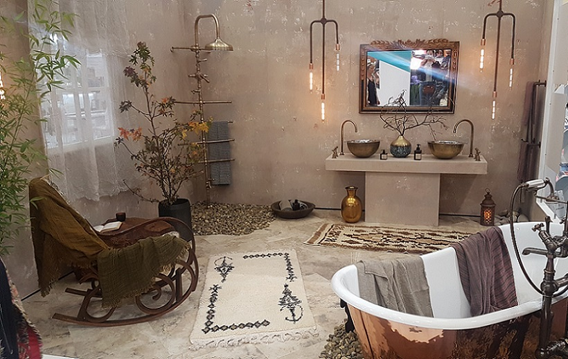 Grand designs room set featuring an industrial style shower and copper bath from EDW Interiors